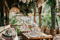 08 The wedding reception was truly tropical, with pampas grass, leaves and blush orchids over the tables