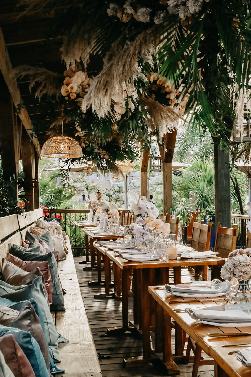The wedding reception was truly tropical, with pampas grass, leaves and blush orchids over the tables