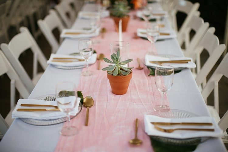 Some other tables were decorated with a pink dip-dye runner and potted succulents