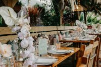 09 The tables were decorated with pastel and white blooms, candles and pastel napkins