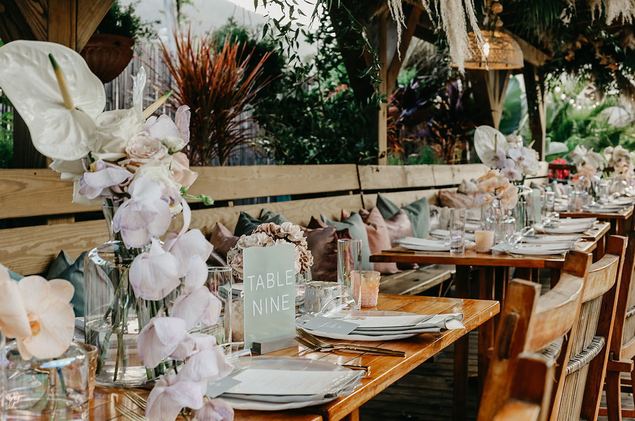 The tables were decorated with pastel and white blooms, candles and pastel napkins