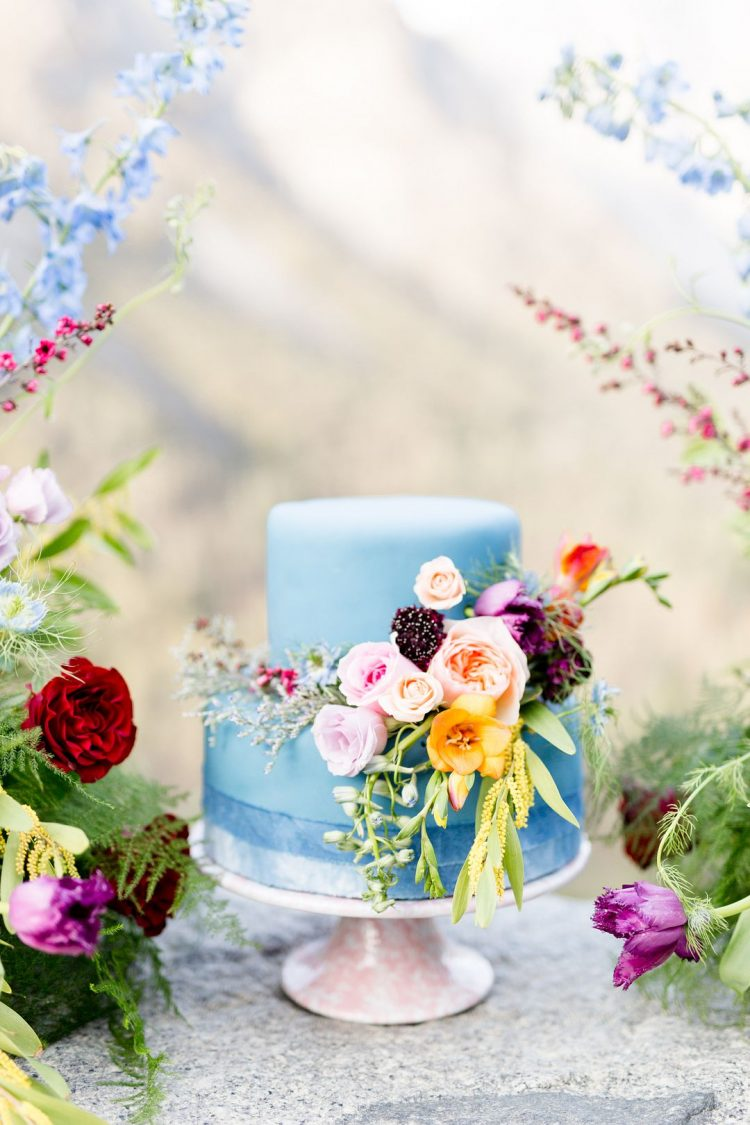 a cute light blue wedding cake with flowers