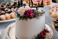 a wedding cake with lots of flowers