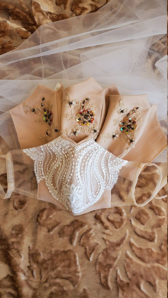 a nude and white lace bridal mark and nude embellished and embroidered bridesmaids' masks for a lovely look