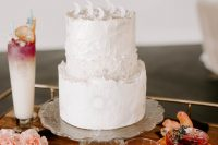 10 The wedding cake was white, with much texture, moons on top and a sun