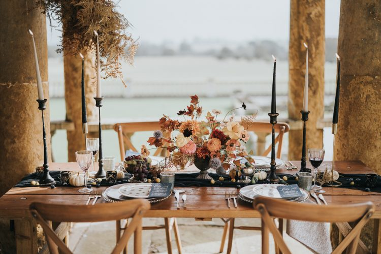 The wedding tablescape was very refined, with a black runner, black candles, bold fall blooms and fruits