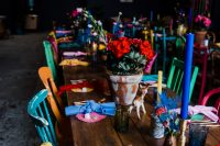 10 The wedding tablescapes were done with colorful napkins, doilies, blooms, candles and mismatching chairs