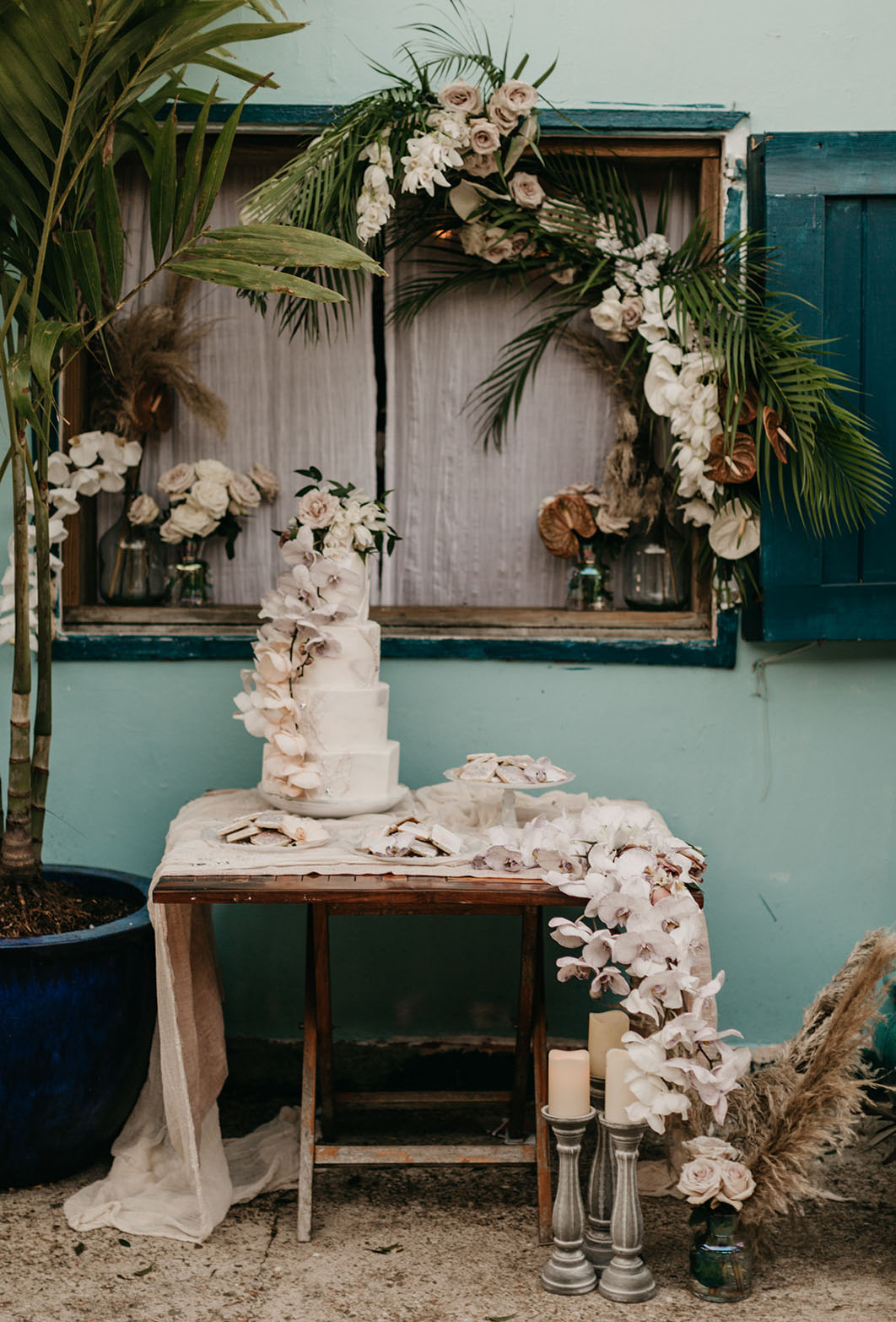 The tropical decor was amazing and romantic, with lush florals and tropical foliage