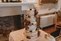 11 The wedding cake was a naked one, with burgundy and blush blooms, greenery and gilded berries