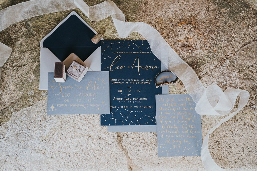 The wedding stationery was also celestial, with grey and navy invites and gold prints