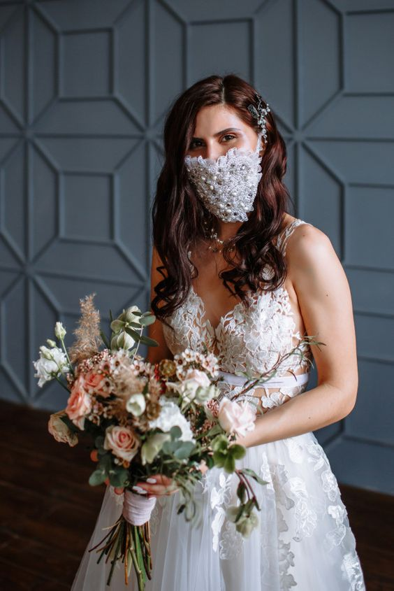 a ruffle and lace fully embellished and pearled face mask that highlights the bridal look and makes it fashion