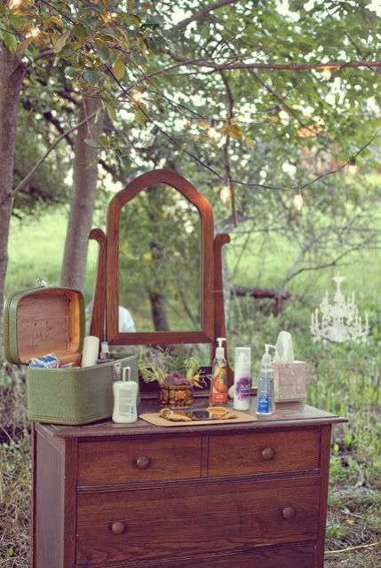 a vintage-styled wedding sanitizer station with various types of sanitizers is a smart idea