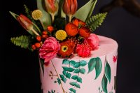 12 The wedding cake featured a bright abstract tier and a botanical painted one, bright blooms and leaves and cacti