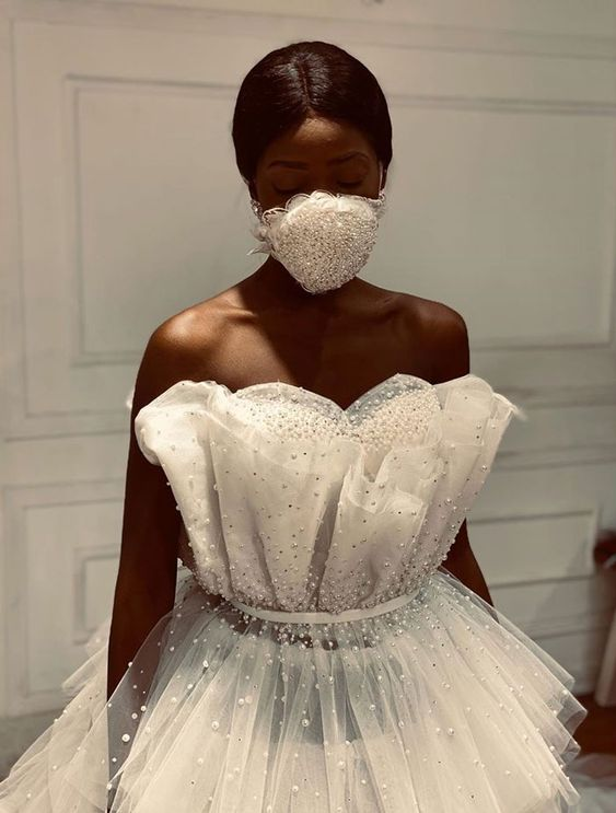 an embellished lace face mask that matches the embellished wedding dress will make your look even more glam-like