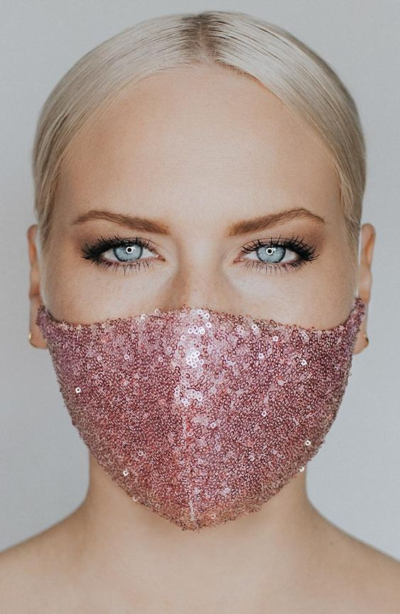 a blush sequin face mask is a glam and romantic touch to the bridal outfit