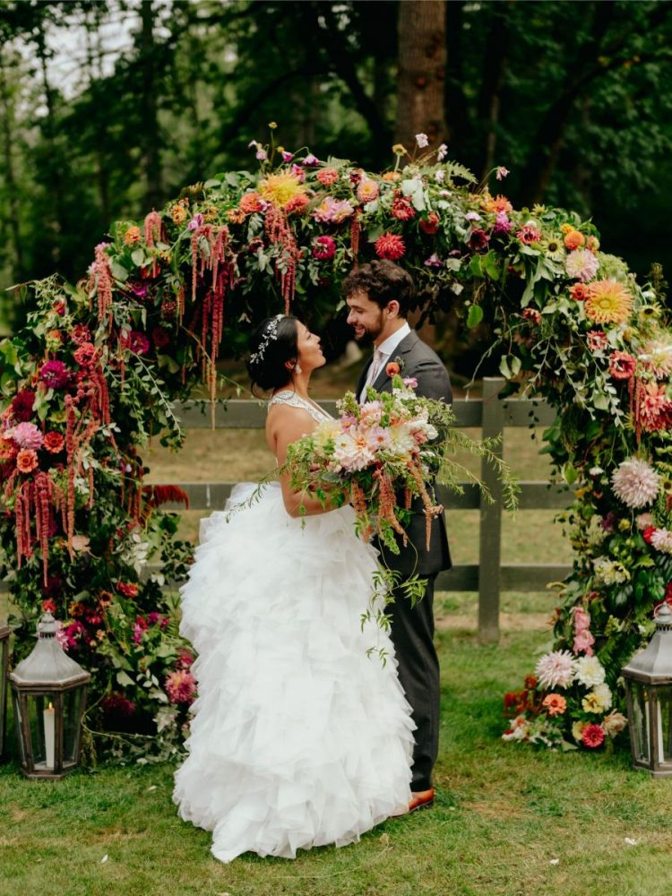 This fun and bold wedding with lots of flowers and greenery took place at a ranch and was filled with blooms