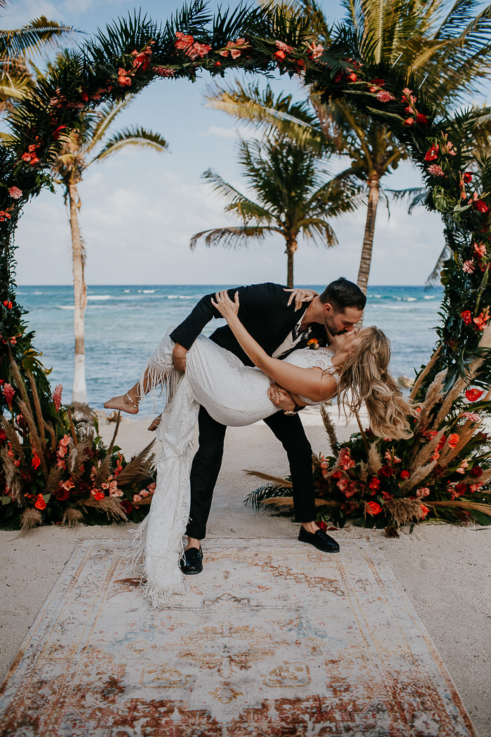 This moody tropical wedding was a boho one, with killing florals and chic style