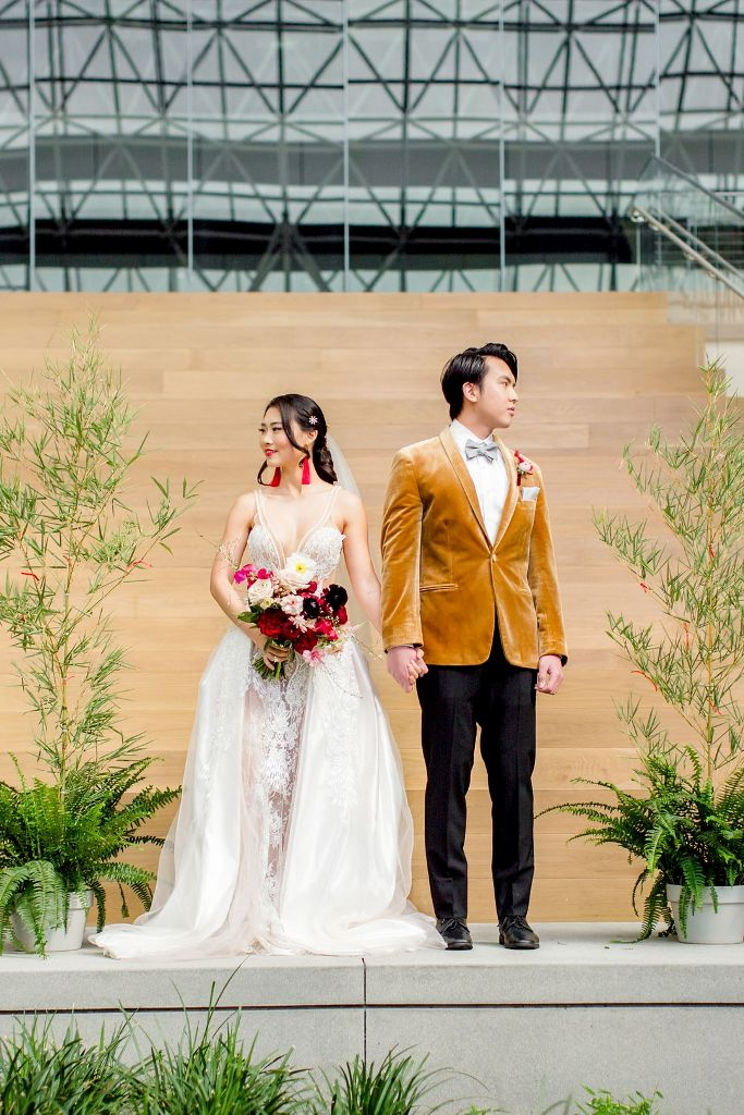The bride was wearing a refined lace wedding dress with an overskirt, the groom was rocking a mustard velvet blazer with black pants and a grey bow tie