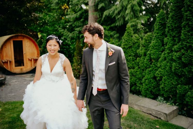 The bride was wearing a whimsy wedding dress with a lace bodice and a V-neckline plus a frou-frou skirt