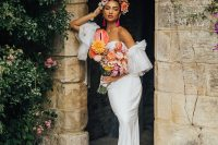 02 The first wedding dress was a plain strapless sheath one, with a train and tulle sleeves plus a bold floral crown and a bright wedding bouquet