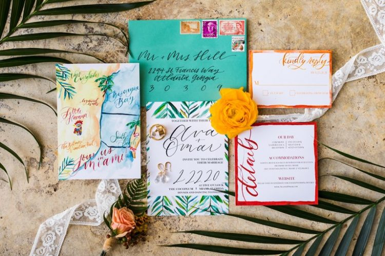The wedding stationery was colorful, with handpainting and coasts