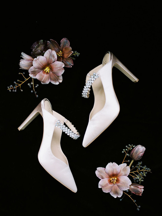 Her look was finished with white heeled mules with embellishments