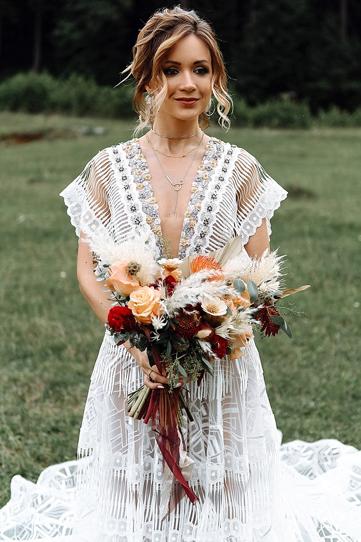 The bride was wearing a breathtaking boho wedding dress with embroidery and embellishments by a Belarus brand