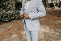 03 The groom was wearing a powder blue suit, a printed bow tie and brown shoes