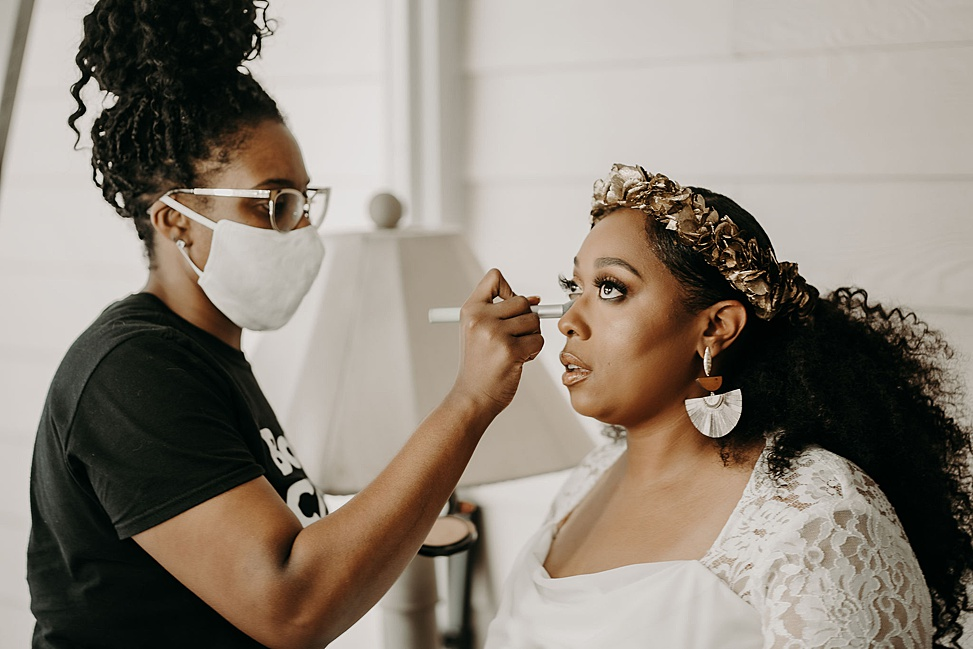 The bride was rocking statement earrings and a gold headpiece