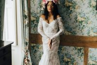 04 The second wedding dress was a lace mermaid one, off the shoulder, with long sleeves and a lush floral crown
