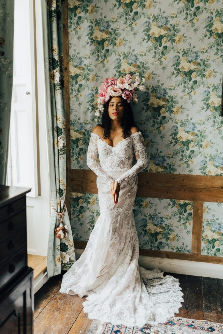 The second wedding dress was a lace mermaid one, off the shoulder, with long sleeves and a lush floral crown