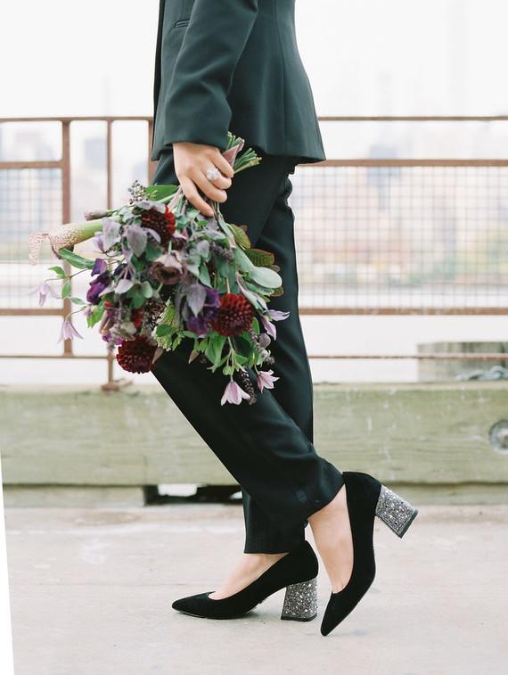 She was wearing black velvet shoes with embellished heels