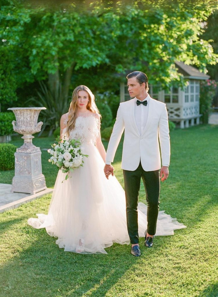 The second bridal look was done with a whimsy gown with a feather bodice and the groom rocked a dinner jacket