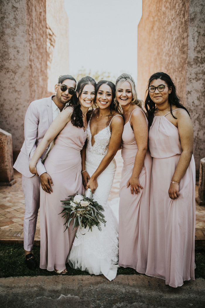 The bridesmaids and bridesman were wearing light pink