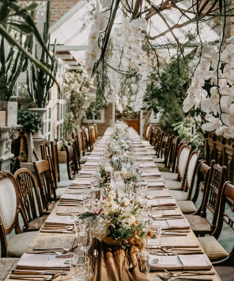 The tables were lined up with white, blush and copper blooms and greenery and lots of greenery around