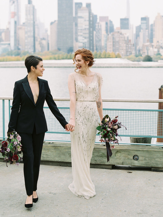 The wedding bouquets were done dark and with jewel tones, with textural greenery and lots of foliage