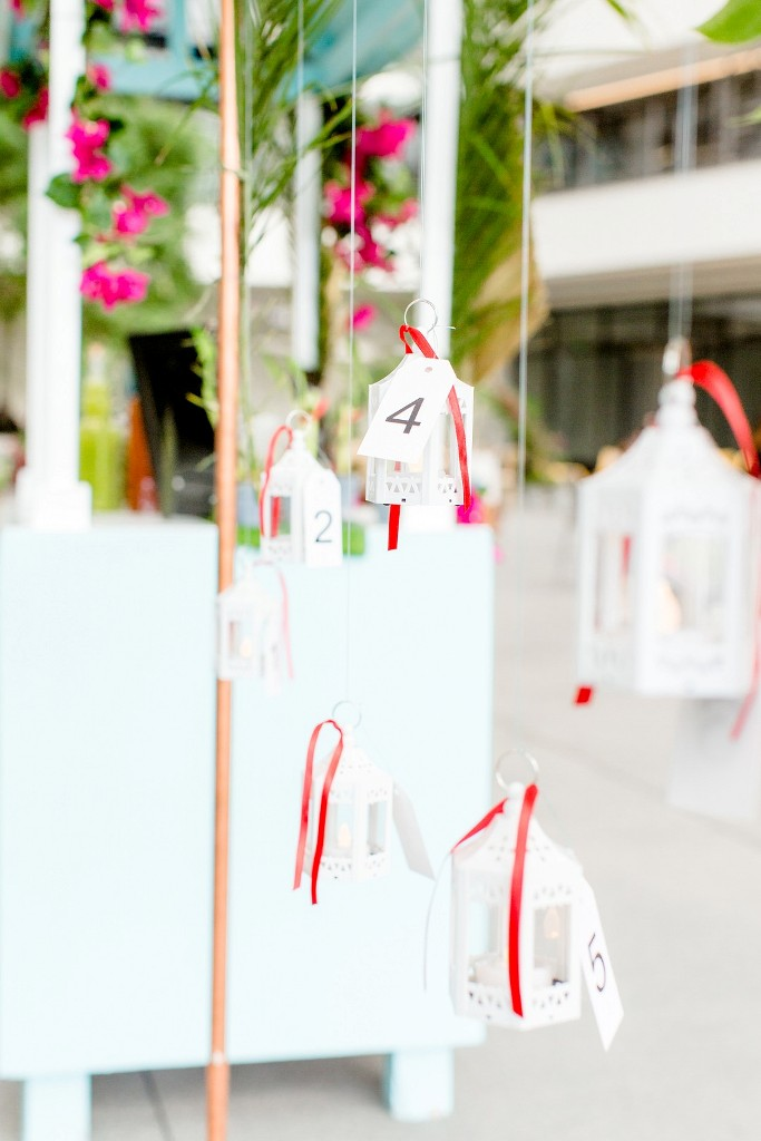 The wedding seating chart was done with hanging lanterns with ribbons
