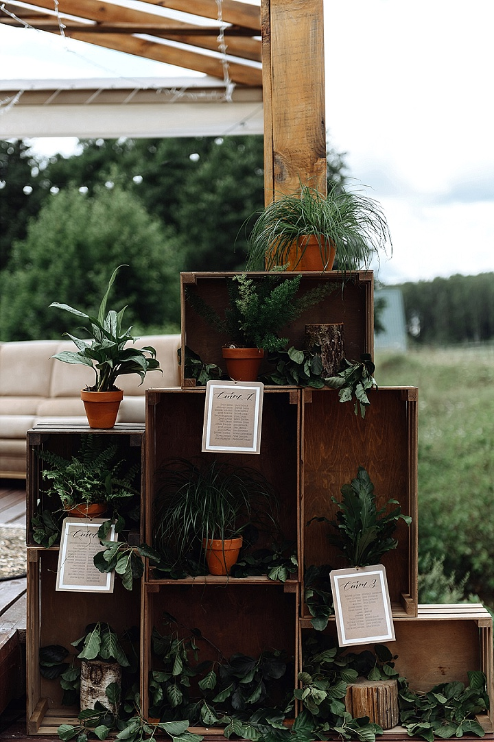 The wedding seating chart was done with potted plants and crates
