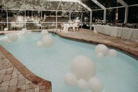 07 The venue was decorated in a minimal and stylish way, with white balloons and blooms