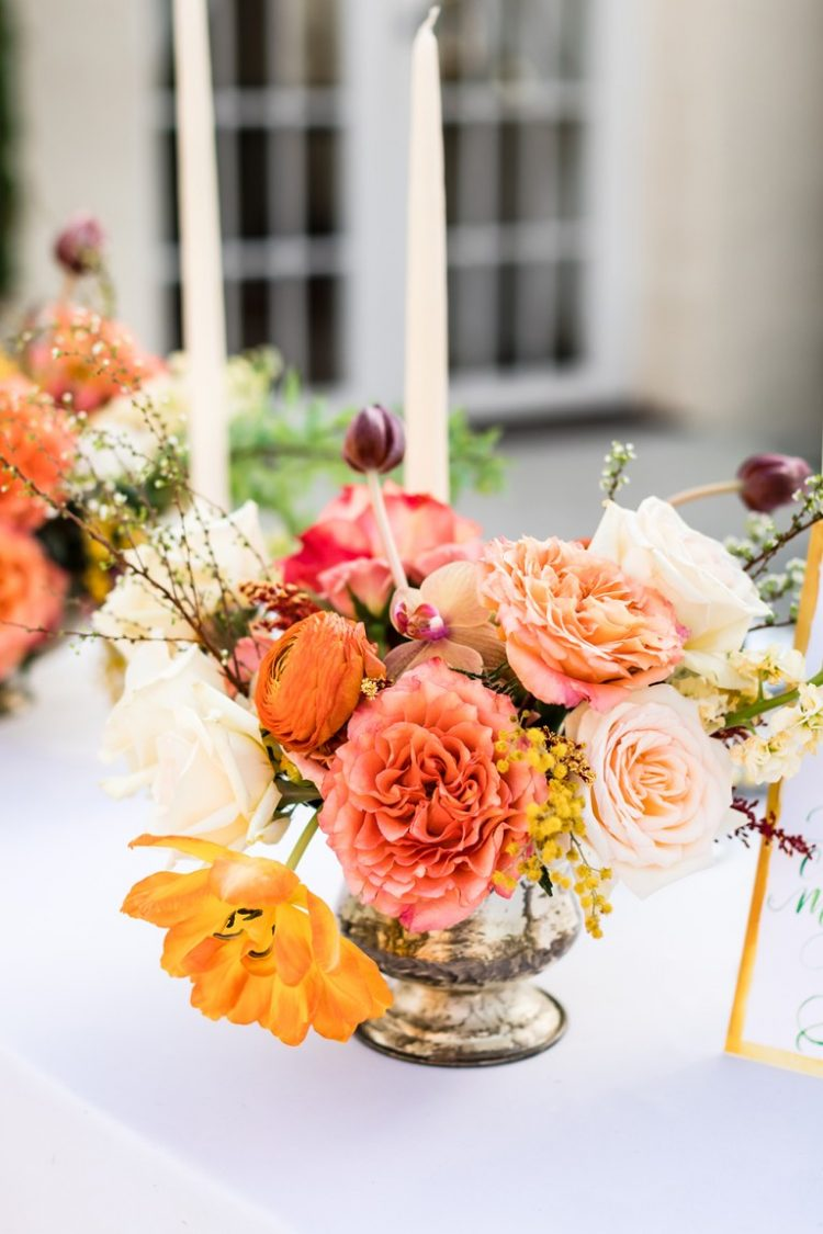 The wedding florals were done bright, with pink, peachy and rust shades