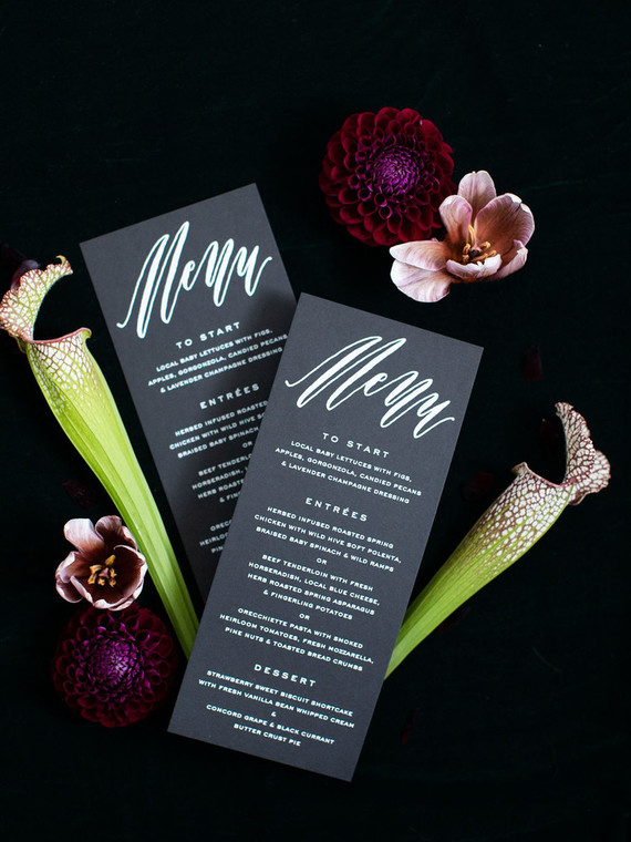 The wedding stationery was black and white, with dark florals around