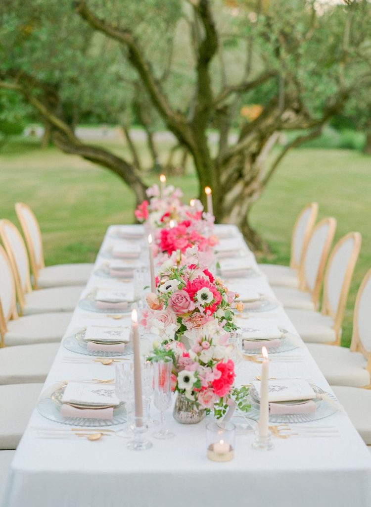 The wedding table setting was done with pink and blush florals, too, with pastel candles and linens