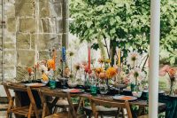 07 The wedding tablescape was super bold, with bright blooms and candles and stationery