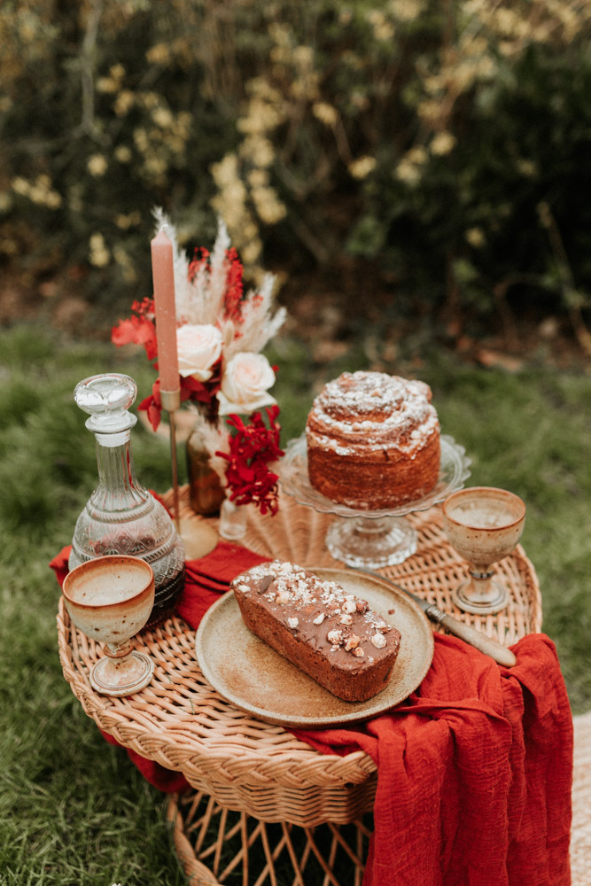There was a small picnic with a floral arrangement, candles, some wine and desserts