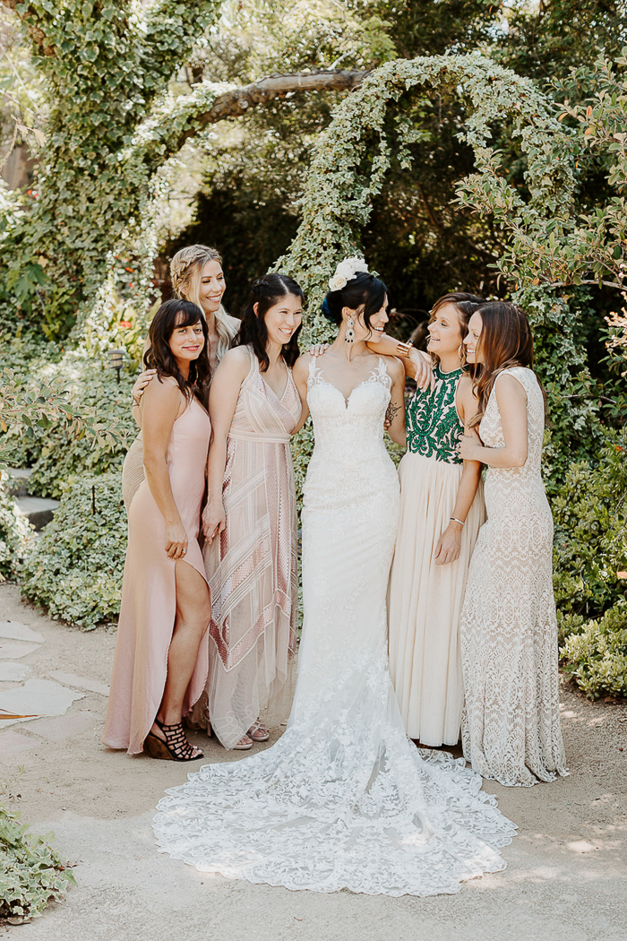 The bridesmaids were wearing mismatching blush and neutral dresses they liked