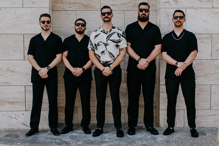 The groomsmen were wearing all black, with no jackets to avoid overheating