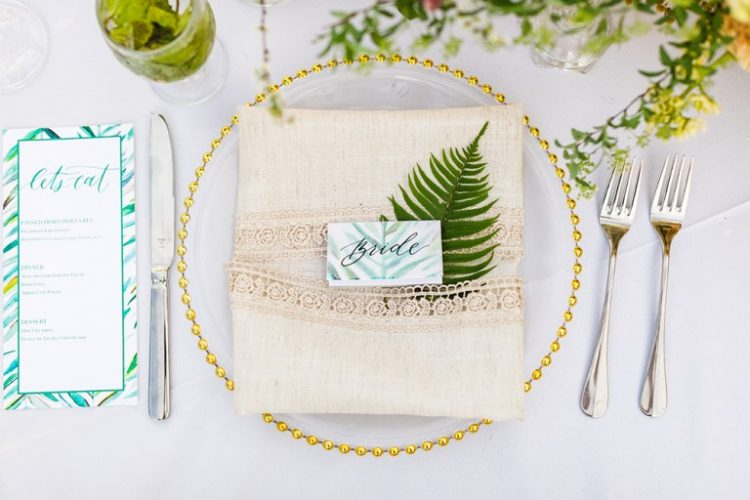 The place setting was done with a gold edge plate, a linen lace napkin and bright tropical stationery