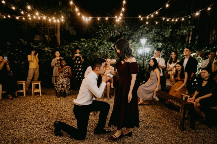 The bride changed for an off the shoulder burgundy velvet midi dress for the reception