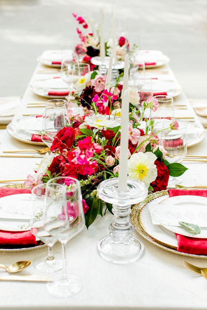 The tablescape was done with super lush and bright blooms and candles and bright napkins