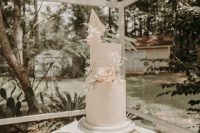 09 The wedding cake was a blush one, with a raw hem, white fronds and greenery plus blush roses